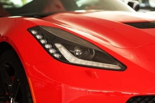 This features an angle shot of a red Corvette after an exterior detailing service